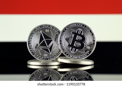 Physical version of Ethereum (ETH), Bitcoin (BTC) and Yemen Flag. 2 largest cryptocurrencies in terms of market capitalization.