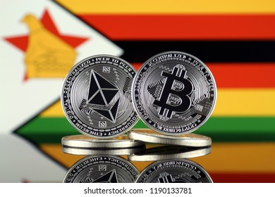 Physical version of Ethereum (ETH), Bitcoin (BTC) and Zimbabwe Flag. 2 largest cryptocurrencies in terms of market capitalization.