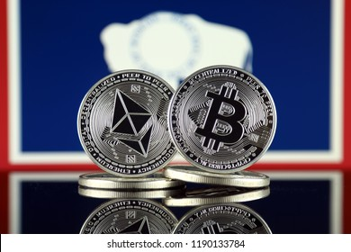 Physical version of Ethereum (ETH), Bitcoin (BTC) and Wyoming State Flag. 2 largest cryptocurrencies in terms of market capitalization.