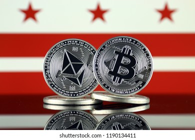 Physical version of Ethereum (ETH), Bitcoin (BTC) and Washington DC Flag. 2 largest cryptocurrencies in terms of market capitalization.