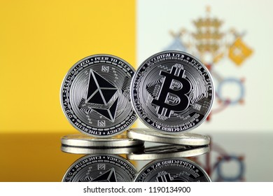 Physical version of Ethereum (ETH), Bitcoin (BTC) and Vatican City Flag. 2 largest cryptocurrencies in terms of market capitalization.