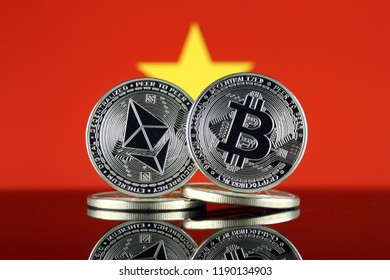 Physical version of Ethereum (ETH), Bitcoin (BTC) and Vietnam Flag. 2 largest cryptocurrencies in terms of market capitalization.