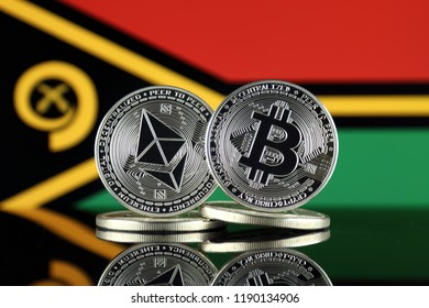 Physical version of Ethereum (ETH), Bitcoin (BTC) and Vanuatu Flag. 2 largest cryptocurrencies in terms of market capitalization.