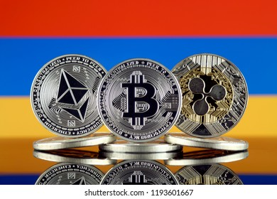 Physical version of Ethereum (ETH), Bitcoin (BTC), Ripple (XRP) and Armenia Flag. The Top 3 Cryptocurrencies by Market Cap.
