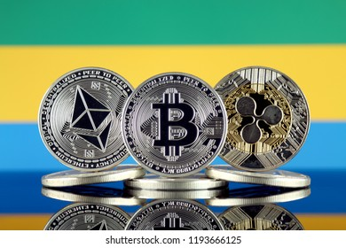 Physical version of Ethereum (ETH), Bitcoin (BTC), Ripple (XRP) and Gabon Flag. The Top 3 Cryptocurrencies by Market Cap.