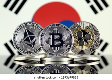 Physical version of Ethereum (ETH), Bitcoin (BTC), Ripple (XRP) and South Korea Flag. The Top 3 Cryptocurrencies by Market Cap.