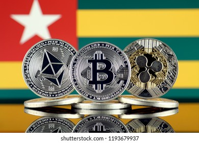 Physical version of Ethereum (ETH), Bitcoin (BTC), Ripple (XRP) and Togo Flag. The Top 3 Cryptocurrencies by Market Cap.