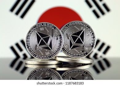 Physical version of Ethereum (ETH) and South Korea Flag. Conceptual image for investors in cryptocurrency, Blockchain Technology, Smart Contracts, Personal Tokens and Initial Coin Offering.