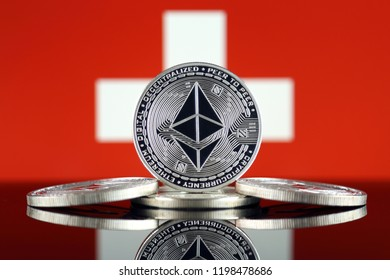 Physical version of Ethereum (ETH) and Switzerland Flag. Conceptual image for investors in cryptocurrency, Blockchain Technology, Smart Contracts, Personal Tokens and Initial Coin Offering.