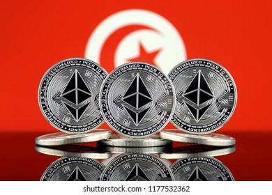 Physical version of Ethereum (ETH) and Tunisia Flag. Conceptual image for investors in cryptocurrency, Blockchain Technology, Smart Contracts, Personal Tokens and Initial Coin Offering.