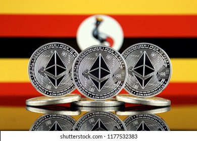 Physical version of Ethereum (ETH) and Uganda Flag. Conceptual image for investors in cryptocurrency, Blockchain Technology, Smart Contracts, Personal Tokens and Initial Coin Offering.