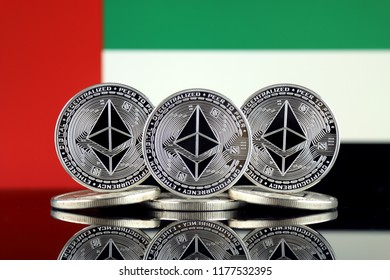 Physical version of Ethereum (ETH) and United Arab Emirates Flag. Conceptual image for investors in cryptocurrency, Blockchain Technology, Smart Contracts, Personal Tokens and Initial Coin Offering.