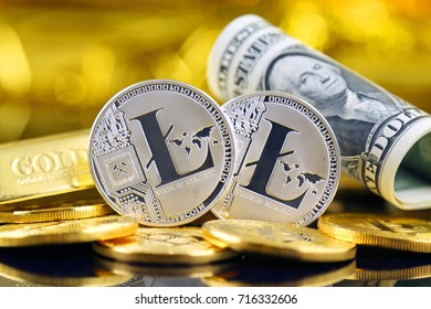 Physical version of Litecoin (new virtual money) and banknotes of one dollar. Exchange Litecoin for a dollar. Conceptual image for worldwide cryptocurrency and digital payment system.