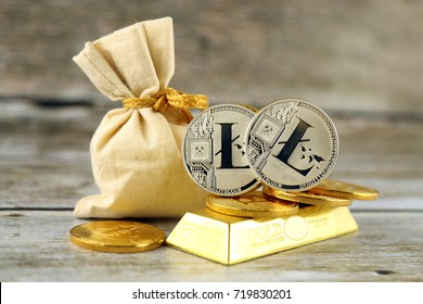 Physical version of Litecoin, new virtual money. Conceptual image for investors in cryptocurrency and gold.