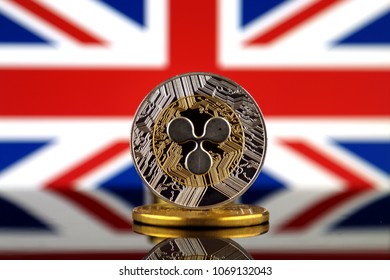 Physical version of Ripple (XRP), new virtual money and United Kingdom Flag. Conceptual image for worldwide cryptocurrency and digital payment system. Studio shot.