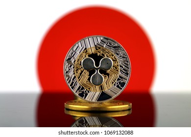 Physical version of Ripple (XRP), new virtual money and Japan Flag. Conceptual image for worldwide cryptocurrency and digital payment system. Studio shot.