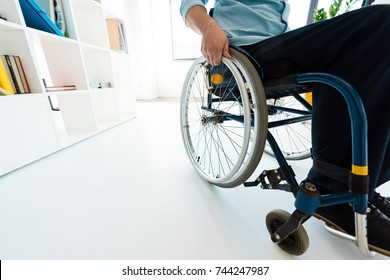 physically handicapped businessman sitting in wheelchair at office