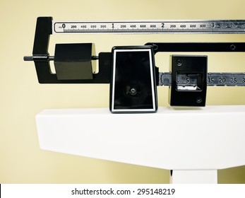 Physician Beam Scale - Medical professional sliding balance weight scale at a physician's office