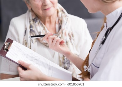 Physician doing medical interview with elderly patient