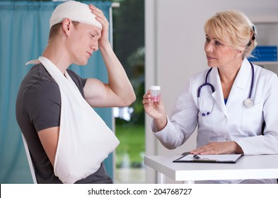 Physician giving to patient pills for headache