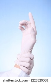 Physician putting on a sterile glove for medical exam