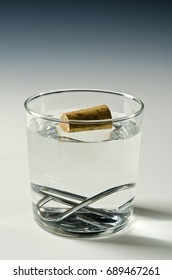 Physics. A cork floats in water and metal objet sinks. Archimedes principle.