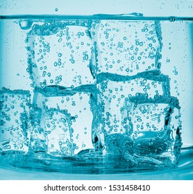 The physics of the ice cube and the beauty of the newly fallen cube creating bubbles around it