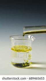Physics. Immiscible fluids. Oil being poured into water.2 of 4 image series.