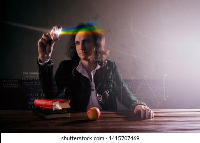 Physics the science of nature, the concept of studying the laws of nature. A young man in the image of Isaac Newton. Looks at the prism, the science of light, optics