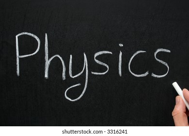 Physics, written with white chalk on a blackboard.