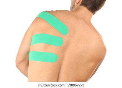 Physio tape applied onto male scapula, isolated on white