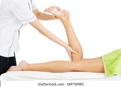 Physio therapist trying to fix the legs over white background