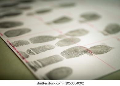 physiological biometrics concept of criminal record by suspect fingerprint for forensic science database in training with cinematic tone