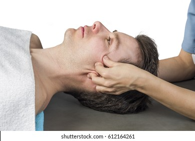 Physiotherapist is activating  trigeminal nerve on white background