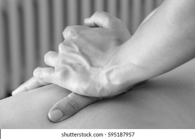 Physiotherapist / chiropractor doing a back massage. Osteopathy.