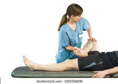 Physiotherapist doing a legs stretching of man patient. Osteopathy over white background