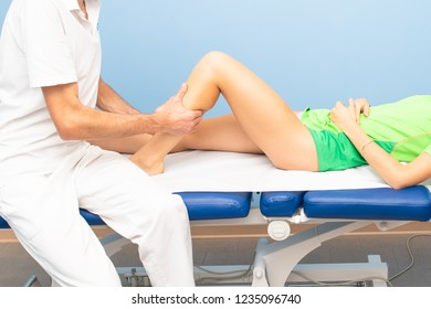 Physiotherapist during a calf massage to an athlete.