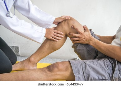 Physiotherapist Giving Exercise In Clinic