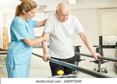 Physiotherapist helps senior man with handicap while running in rehab
