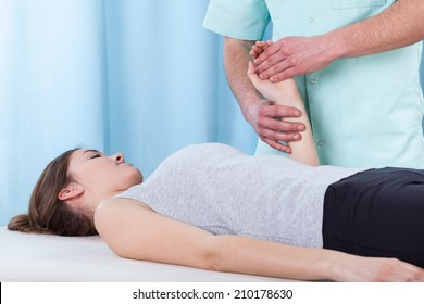 Physiotherapist treating the wrist after the injury