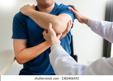 Physiotherapist working concept, Doctor and patient suffering or Chiropractor examining from shoulder pain in clinic medical office