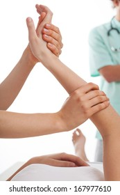 Physiotherapists treating a patient with hand ponds disease
