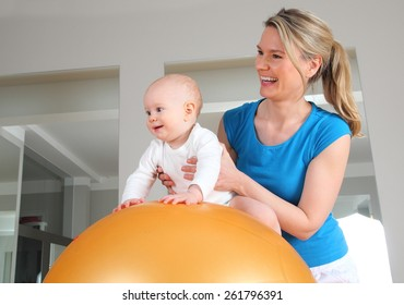 A Physiotherapy with Baby on a Fitness Ball