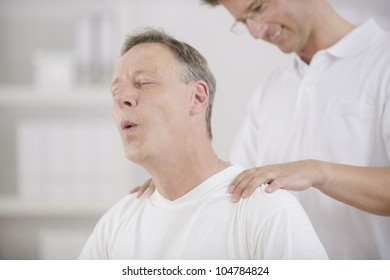 Physiotherapy: Physiotherapist massaging patient at office