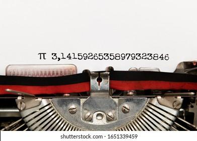 Pi irrational number close up printed on paper typewriter, Pi day symbol