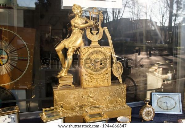 Piacenza, Emilia Romagna Italy - March 10 2021: Golden antique clock with Orpheus figure on it