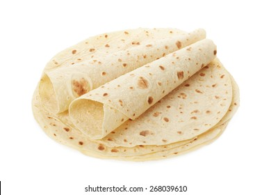 Piadina, italian tortilla heap with wraps isolated on white, clipping path included