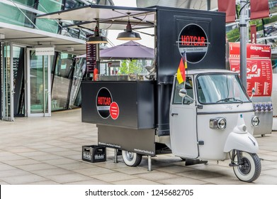 Piaggio Ape Classic 400 platform truck, converted into a rolling sales stand for streetfood with curry sausage, hamburgers, French Fries and Fritz-Kola, Wolfsburg, Germany, June 15, 2018
