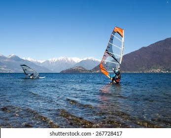 Pianello del Lario, Como - Italy - March 28, 2015: Windsurfer start from the beach and goes in search of strong winds towards the center of the lake.