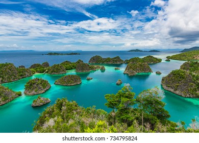 Pianemo Islands, Blue Lagoon with Green Rocks, Raja Ampat, West Papua, Indonesia.